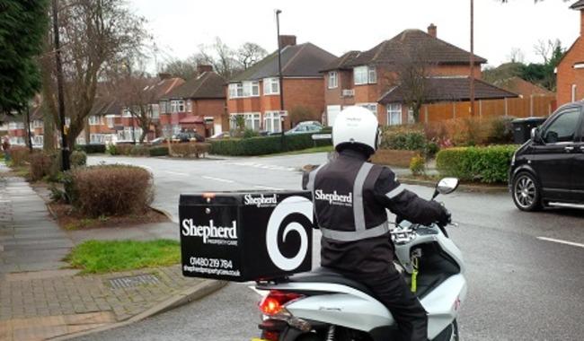 Shepherd Property Care employee on motorbike.
